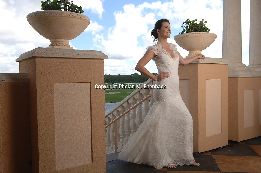 A woman stands at the top of a flight of stairs in a wedding dress in Orlando, Florida.