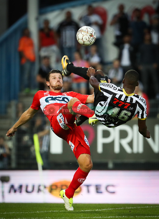 July 29, 2017 - Charleroi, BELGIUM - Kortrijk's Stijn De Smet and Charleroi's Dodi Lukebakio fight for the ball during the Jupiler Pro League match between Sporting Charleroi and KV Kortrijk, in Charleroi, Saturday 29 July 2017, on the first day of the Jupiler Pro League, the Belgian soccer championship season 2017-2018. BELGA PHOTO VIRGINIE LEFOUR (Credit Image: © Virginie Lefour/Belga via ZUMA Press)