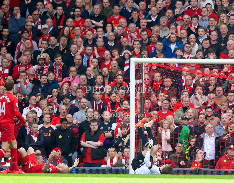 LIVERPOOL, ENGLAND - Sunday, April 13, 2014: Liverpool's goalkeeper Simon Mignolet looks dejected as Manchester City score the second goal to level the score at 2-2 during the Premiership match at Anfield. (Pic by David Rawcliffe/Propaganda)