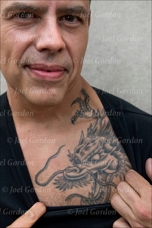 Nelson showing his full wrap Dragon on his arm to chest but would not talk off his shirt. by Red Parlour Tattoo in Queens NY<br /> <br /> Body art or tattoos has entered the mainstream it is no longer considered a weird kind of subculture.<br /> <br /> &quot;According to a 2006 Pew survey, 40% of Americans between the ages of 26 and 40 have been tattooed&quot;.<br /> <br /> release # 2713