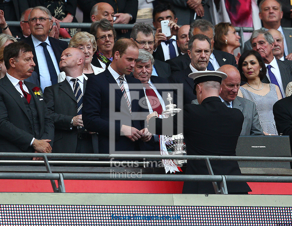 Prince William is given the FA cup trophy to present to Arsenal after the The FA Cup Final match at Wembley Stadium, London<br /> Picture by Paul Terry/Focus Images Ltd +44 7545 642257<br /> 17/05/2014
