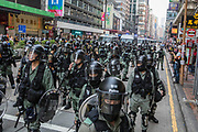 HONG KONG: 13 October 2019 <br /> Running battles between protesters and riot police continued today as demonstrators move into their 19th consecutive week of protests in Hong Kong. The movement's aim, which started on June 1st, originally wanted to get rid of a controversial extradition bill which has since been removed, however the protests have formed into a wider fight against police brutality and the ability to wear a mask without fear of arrest.<br /> Rick Findler / Story Picture Agency