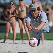 4/28/12  --- SPORTS SHOOTER ACADEMY --- Sports Shooter Academy co-founder Robert Hanashiro dives and misses returning a shot, much to the amusement of the professional beach volleyball players in the background. The players were part of a shoot during uring SSA IX.<br /> Photo by Judy Zabrecky, Sports Shooter Academy Behind the Scenes with the cast and crew of Sports Shooter Academy.