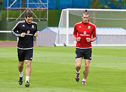 DINARD, FRANCE - Monday, July 4, 2016: Wales' Gareth Bale and head of performance Ryland Morgans during a training session at their base in Dinard as they prepare for the Semi-Final match against Portugal during the UEFA Euro 2016 Championship. (Pic by David Rawcliffe/Propaganda)