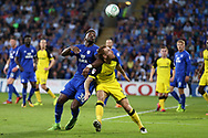 Tom Naylor of Burton Albion holds off a challenge from Omar Bogle of Cardiff city. Carabao Cup 2nd round match, Cardiff city v Burton Albion at the Cardiff City Stadium in Cardiff, South Wales on Tuesday 22nd August  2017.<br /> pic by Andrew Orchard, Andrew Orchard sports photography.