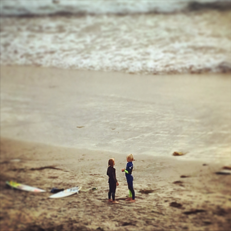 Young surfers getting ready to head out into Del Mar surf.