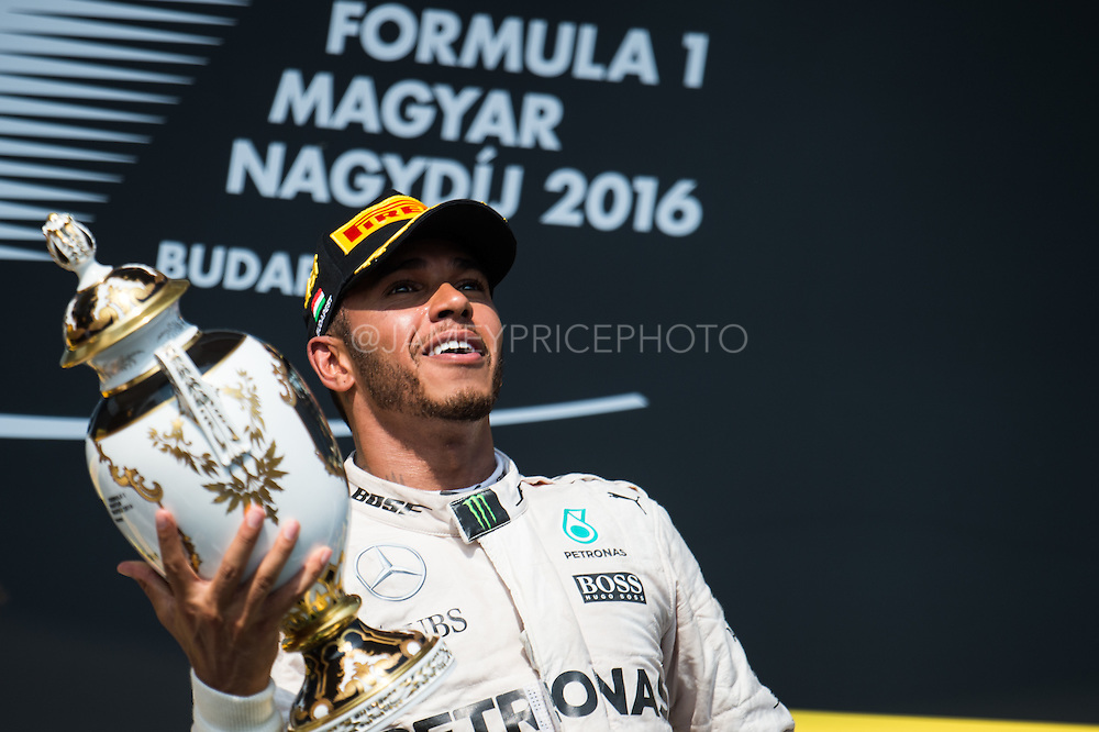 July 21-24, 2016 - Hungarian GP, Lewis Hamilton (GBR), Mercedes throws his trophy after winning the Hungarian GP