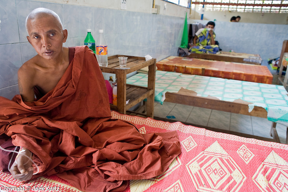 """23 FEBRUARY 2008 -- MAE SOT, TAK, THAILAND: Ban Di Tah, a Buddhist monk from Burma, gets treatment for malaria at the Mae Tao Clinic in Mae Sot, Thailand. Malaria is one the most common ailments treated at the clinic. The clinic treated more than 80,000 people in 2007, all Burmese. Most of them are living illegally in Thailand, but many come to the clinic from Burma because they either can't afford medical care in Burma or because it isn't available to them. There are millions of Burmese refugees living in Thailand. Many live in refugee camps along the Thai-Burma (Myanmar) border, but most live in Thailand as illegal immigrants. They don't have papers and can not live, work or travel in Thailand but they do so """"under the radar"""" by either avoiding Thai officials or paying bribes to stay in the country. Most have fled political persecution in Burma but many are simply in search of a better life and greater economic opportunity.  Photo by Jack Kurtz"""