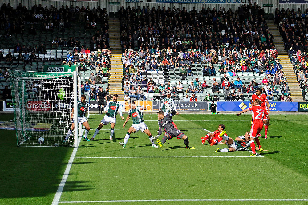 Goal - Aidan Nesbitt (21) of Milton Keynes scores a goal to give a 0-1 lead to the away team during the EFL Sky Bet League 1 match between Plymouth Argyle and Milton Keynes Dons at Home Park, Plymouth, England on 9 September 2017. Photo by Graham Hunt.