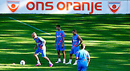Dutch international football player Arjen Robben, Khalid Boulahrouz , and Wesley Sneijder  during the training for the trainingcamp of the Netherlands national football team in Hoenderloo on May 28, 2012. AFP PHOTO/ ROBIN UTRECHT