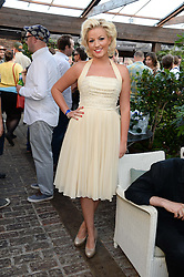 NATALIE COYLE attending the Warner Bros. & Esquire Summer Party held at Shoreditch House, Ebor Street, London E1 on 18th July 2013.