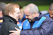 Reading's Manager Steve Clarke greets Bolton Wanderers manager Neil Lennon during the Sky Bet Championship match between Reading and Bolton Wanderers at the Madejski Stadium, Reading, England on 21 November 2015. Photo by Mark Davies.