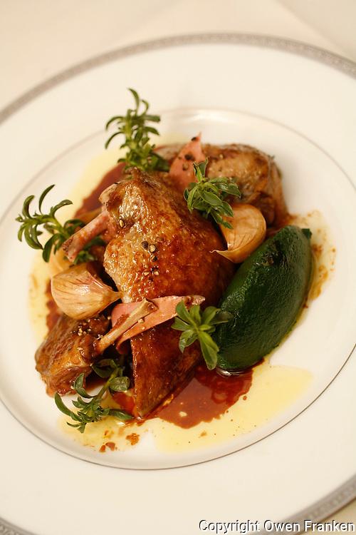 .l'Ambroisie, Chef Bernard Pacaud, Place des Vosges, Paris..l'Ambroisie is a Michelin three star restaurant...Pigeon à l'ail nouveau confit, étuvée de févettes à la sarriette. ..............