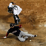 Boston Red Sox left fielder Cody Ross scores on athree-run double as Chicago White Sox catcher A.J. Pierzynski (12) can't handle the throw in the sixth inning Friday, April 27, 2012 at U.S. Cellular Field.