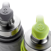 Gray and Gereen Anchor Hocking LifeProof water bottles on a light background.