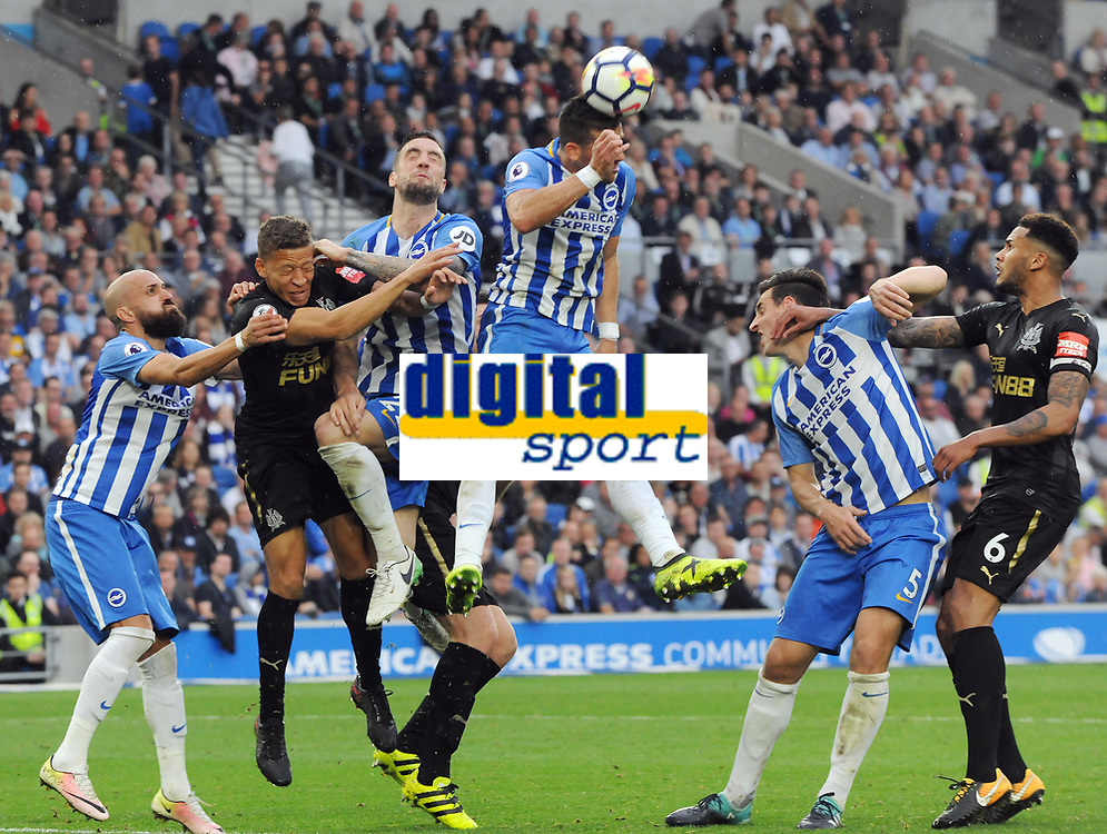 Football - 2017 / 2018 Premier League - Brighton & Hove Albion vs. Newcastle United<br /> <br /> Shane Duffy and Tomer Hemed of Brighton combine to out jump Dwight Gayle of Newcastle at The Amex.<br /> <br /> COLORSPORT/ANDREW COWIE