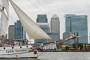 The Loth Lorien passes Canary Wharf - Royal Greenwich Tall Ships Festival with a fleet of square rigged ships moored on the Thames at Greenwich and Woolwich. The fleet includes two of the biggest Class A Tall Ships - the Dar Mlodziezy and Santa Maria Manuela - which are moored on Tall Ships Island in the river off Greenwich. Tall Ships Festival Day on Saturday 29 August featured free family entertainment and the chance to enjoy a taste of life on the high seas.