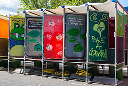 Composting toilets with 'graphic' doors await the crowds as Shops and properties in the west London area of the Notting Hill Carnival prepare for the hundreds of thousands of revellers by erecting protective hoardings. London, August 24 2018.