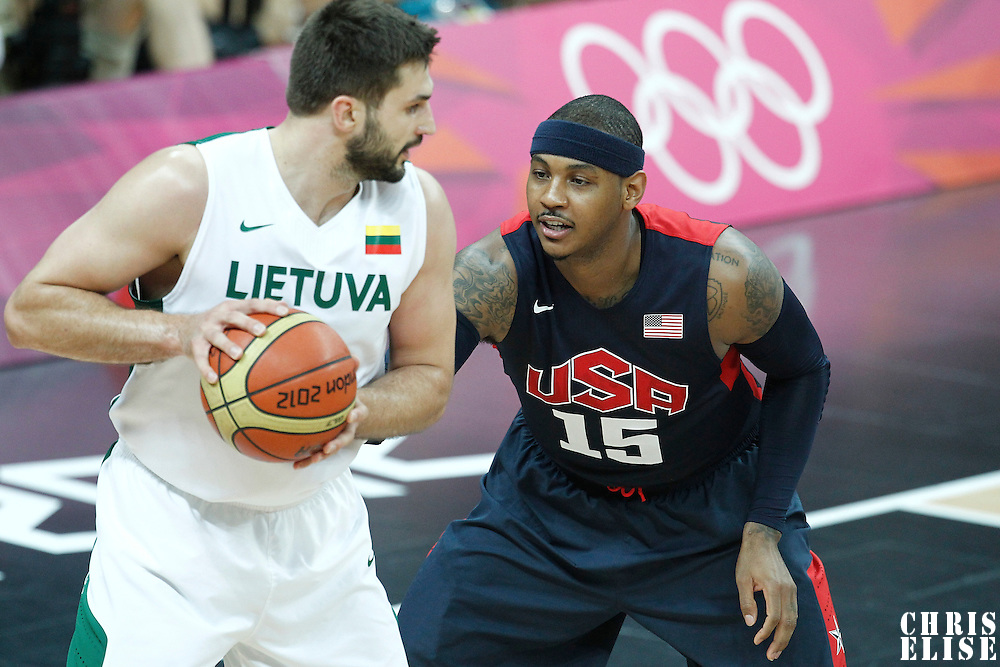 04 August 2012: USA Carmelo Anthony defends on Lithuania Linas Kleiza during 99-94 Team USA victory over Team Lithuania, during the men's basketball preliminary, at the Basketball Arena, in London, Great Britain.