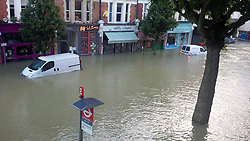© London News Pictures. 07/08/2013. London, UK. The centre of Herne Hill in South London flooded with water this morning (07/08/2013) after a water main burst near the station. Photo credit: Crispin Sugden/LNP
