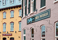English translation from the french doesn't quite match on the Hotel Belley on Rue Saint-Paul, Québec City.