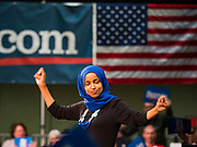 02 MARCH 2020 - ST. PAUL, MINNESOTA: US Representative ILHAN OMAR (D-MN) dances while on stage at a Bernie Sanders Get Out the Vote rally in the RiverCentre in St. Paul. Rep. Omar endorsed Sanders for President and has been a Sanders surrogate on the campaign trail. More than 8,400 people attended the rally. Minnesota is a Super Tuesday state this year and Minnesotans will go to the polls Tuesday. Minnesota Sen. Amy Klobuchar was expected to win her home state, but she dropped out early Monday, March 2.        PHOTO BY JACK KURTZ
