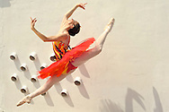MR. Model relased photo. Ballerina dancing and leaping with a red dress.