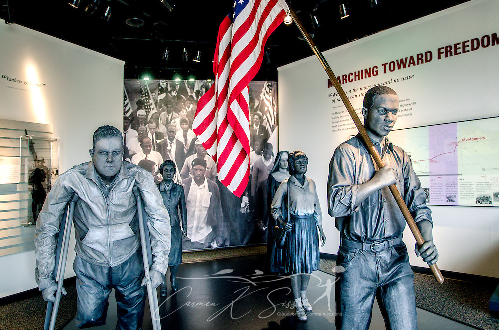 "Bronze statues depicting the foot soldiers of the civil rights movement's Selma to Montgomery march are displayed at Lowndes Interpretive Center, Feb. 3, 2015, in Hayneville, Ala. Dallas County Sheriff Jim Clark, Alabama state troopers, and newly deputized local citizens attacked civil rights demonstrators as they attempted to cross Selma's Edmund Pettus Bridge, March 7, 1965. More than 60 protesters were hospitalized due to their injuries, and the day became known as ""Bloody Sunday."" The violent confrontation marked a pivotal turning point in the Civil Rights movement.  On March 21, 1965, activists crossed the Edmund Pettus Bridge and marched 54 miles to the Alabama State Capitol in Montgomery. The Voting Rights Act was passed, Aug. 6, 1965, outlawing poll taxes, literacy tests, and other methods used to prevent blacks from voting. (Photo by Carmen K. Sisson/Cloudybright)"