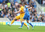 Preston North End defender Calum Woods (15) and Brighton striker, Sam Baldock (9) during the Sky Bet Championship match between Brighton and Hove Albion and Preston North End at the American Express Community Stadium, Brighton and Hove, England on 24 October 2015.