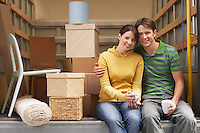 Couple Sitting in Back of Moving Van