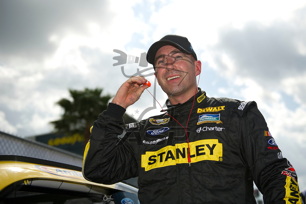Daytona Beach, FL - FEB 19, 2012:  Marcos Ambrose (9) gets out of the car during qualifying for the Daytona 500 at the Daytona International Speedway in Daytona Beach, FL.