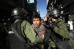 A man is arrested in La Paz, Bolivia. Three weeks of protests that have rocked Bolivia led to President Mesa offering his resignation, for the second time this year, to congress. Blockades, protests and concentrations have brought the country to a standstill and confrontations between police and protestors happen daily.  At the center of the conflict is the indigenous movement's desire to nationalize gas and rewrite the constitution. Congress must now meet to decide of they will accept the president's resignation.