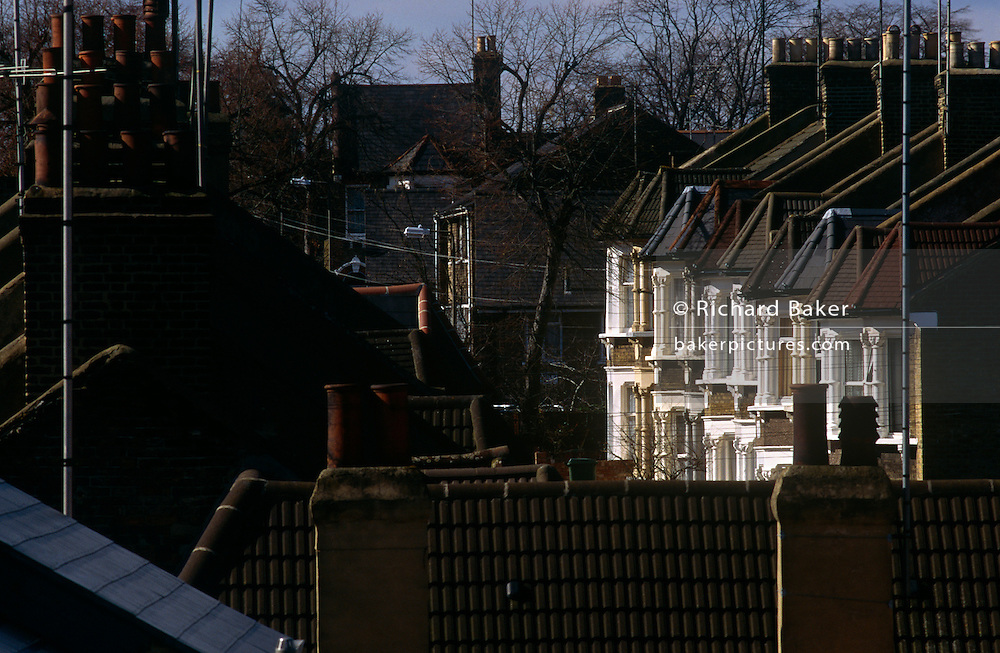 Rooftops of Greenwich housing and Victorian terraced properties seen in a foreshortened perspective.