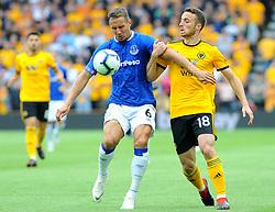 Phil Jagielka of Everton jostles with Diogo Jota of Wolverhampton Wanderers - Mandatory by-line: Nizaam Jones/JMP - 11/08/2018/ - FOOTBALL -Molineux  - Wolverhampton, England - Wolverhampton Wanderers v Everton - Premier League