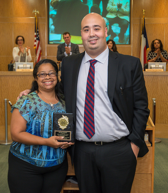 Employee of the Month Beverly Batiste, left, and Rick Cruz, right, pose for a photograph during a meeting of the Houston ISD Board of Trustees meeting, September 11, 2014.