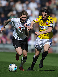 Derby Jeff Hendrick, battles withBrentford Jonathan Douglas,  Derby County v Brentford, Sy Bet Championship, IPro Stadium, Saturday 11th April 2015. Score 1-1,  (Bent 92) (Pritchard 28)<br /> Att 30,050