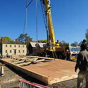 As it is raised, the wall begins to bend/bow in the center.