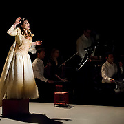 "November 12, 2013 - New York, NY : Soprano Anna Caterina Antonacci, left, -- accompanied by soloists from the orchestra Les Siècles -- performs in a dress rehearsal for the U.S. premiere of ""Era la Notte,"" staged by Juliette Deschamps as part of Lincoln Center's White Light Festival, at the Rose Theater in Manhattan on Tuesday evening. CREDIT: Karsten Moran for The New York Times"