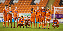BLACKPOOL, ENGLAND - Wednesday, December 18, 2013: Blackpool players look dejected as they lose to Liverpool after a penalty shoot-out during the FA Youth Cup 3rd Round match at Bloomfield Road. (Pic by David Rawcliffe/Propaganda)