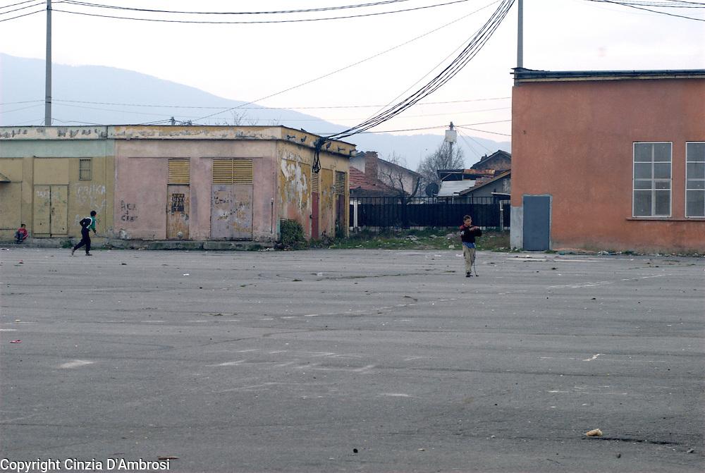 Roma gypsy children playing outside the segregated school in the roma ghetto of Fakulteta in Sofia, Bulgaria.
