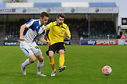 Chesham United midfielder Dave Pearce tackles Bristol Rovers defender Tom Lockyer during the The FA Cup match between Bristol Rovers and Chesham FC at the Memorial Stadium, Bristol, England on 8 November 2015. Photo by Alan Franklin.