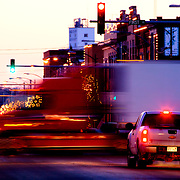 Dusk photo of tractor trailer in motion going through intersection of Main St and Hwy 281 in Pratt, Kansas.