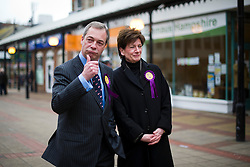 © London News Pictures. 01/03/2013 . Eastleigh, UK.  UKIP (UK INdependence Part) leader NIGEL FARAGE (Left) and  UKIP candidate, DIANE JAMES (right) walking through Eastleigh town centre after the party came second in the Eastleigh by-election. Photo credit : Ben Cawthra/LNP