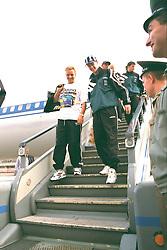 VLADIKAVKAZ, RUSSIA - Monday, September 11, 1995: Liverpool's Rob Jonesa and Steve McManaman step off the Aeroflot plane at Vladikavkaz airport as the team arrive in Russia ahead of the UEFA Cup 1st Round 1st Leg match against FC Alania Spartak Vladikavkaz. (Photo by David Rawcliffe/Propaganda)