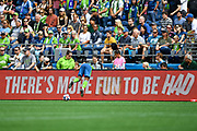 Seattle Sounders midfielder Jordy Delem (21) runs into a LED board during a MLS soccer match against the New England Revolution on Saturday, Aug. 10, 2019, in Seattle. The teams played to a 3-3 tie. (Alika Jenner/Image of Sport)
