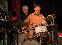 Mark Ivester on drums with Clipper Anderson behind perform with the faculty trio before the PLU Jazz Ensemble takes the stage at Tula's Jazz Club in Seattle on Sunday, May 3, 2015. (Photo: John Froschauer/PLU)