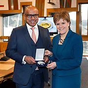 International metals and industrials entrepreneur Sanjeev Gupta today presented First Minister, Nicola Sturgeon, with a special commemorative medal cast from Lochaber aluminium to mark two years since his group the GFG Alliance began investing in Scottish industry. The Group has already invested £500m in steel, aluminium, renewable energy and manufacturing operations and Mr Gupta disclosed that he is considering projects that would take this figure up to £1billion. <br /> <br /> Picture Robert Perry i-Images 13th March 2018