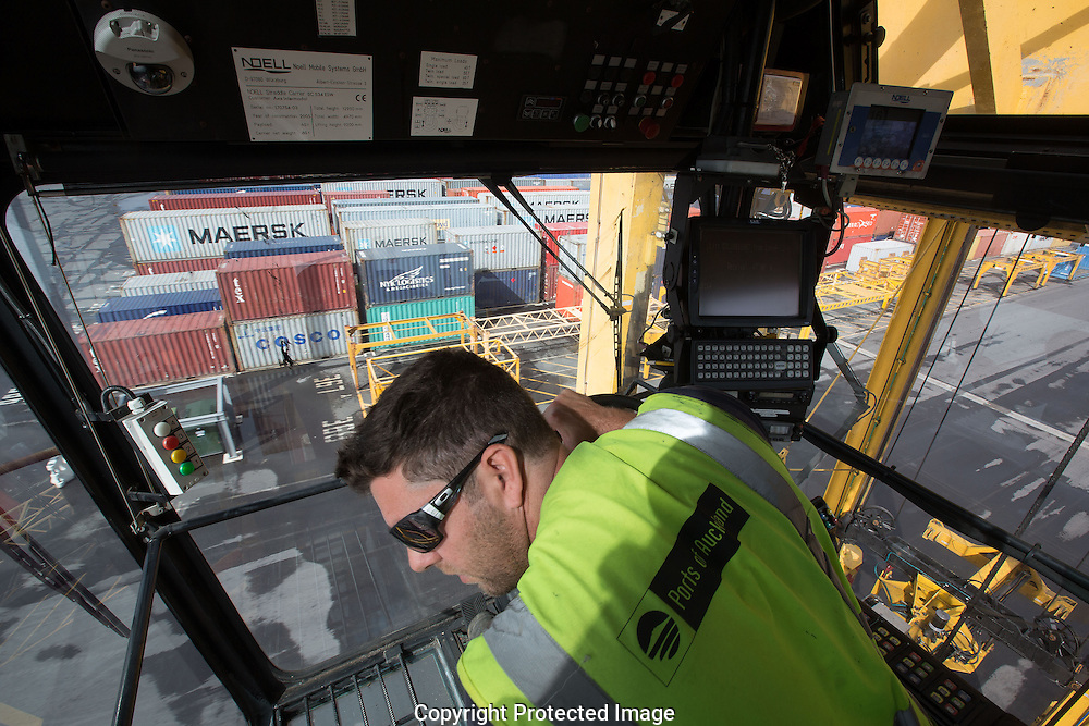 Straddle cranes work  loading ships on the Ports of Auckland    , North Island ,New Zealand   , New Zealand  on Sept 5th  2014   Photograph by Brendon O'Hagan /Bloomberg News