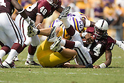 Baton Rouge, LA - SEPTEMBER 30:  Omarr Conner #14 of the Mississippi State Bulldogs gets sacked against the LSU Tigers at Tiger Stadium on September 30, 2006 in Baton Rouge, Louisiana.  The Tigers defeated the Bulldogs 48 - 17.  (Photo by Wesley Hitt/Getty Images) *** Local Caption *** Omarr Conner