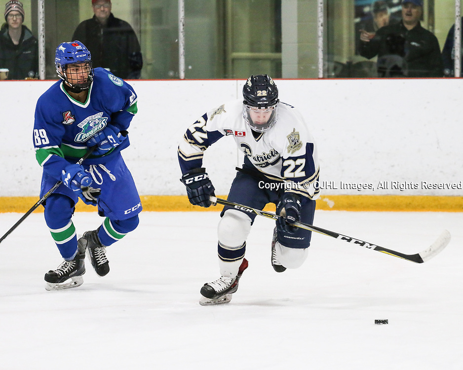 BURLINGTON, ON  - NOV 3,  2017: Ontario Junior Hockey League game between the Toronto Patriots and the Burlington Cougars. Josiah Degazon #89 of the Burlington Cougars follows the play and Ryan Wells #22 of the Toronto Patriots skates with the puck.<br /> (Photo by Spencer Smye / OJHL Images)